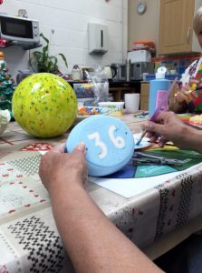 hand-painting ceramics at hobby class